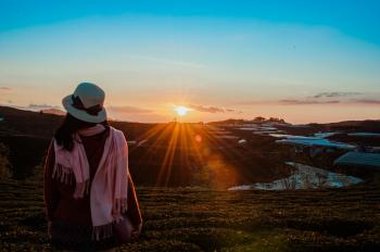Person Wearing White Fedora Hat and Pink Scarf during Golden Hour