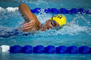 Person Wearing Yellow Swimming Cap on Swimming Pool