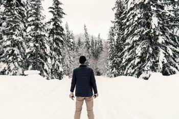 Photo of a Man in the Snowy Forest
