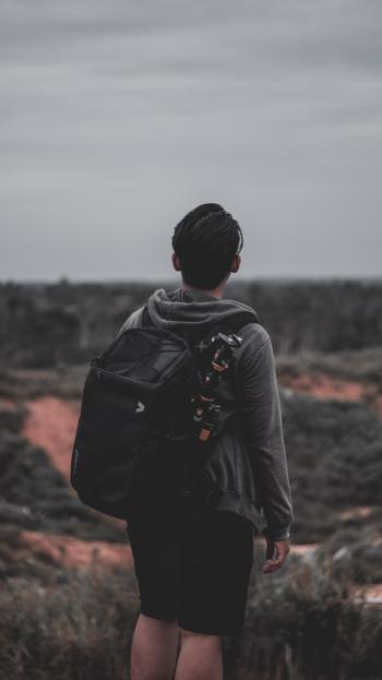 Photo of a Man Wearing Black Backpack