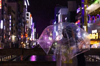 Photo of a Person Holding an Umbrella