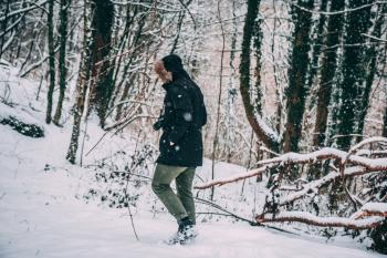 Photo of a Person in the Snowy Forest