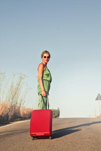Photo of a Woman Holding her Luggae