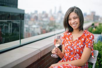 Photo of a Woman Sitting on Chair Holding Wine Glass
