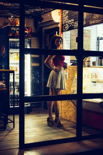 Photo of a Woman Standing in Front of the Counter