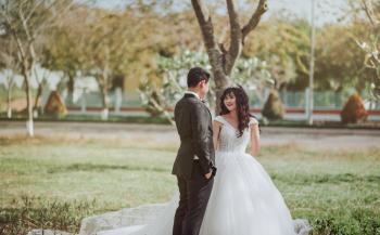 Photo of Bride and Groom Talking