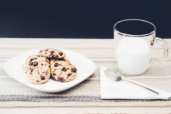 Photo Of Clear Mug Beside Plate With Cookies