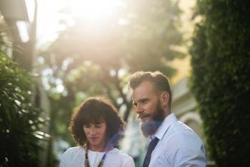 Photo of Couple Wearing White Shirts
