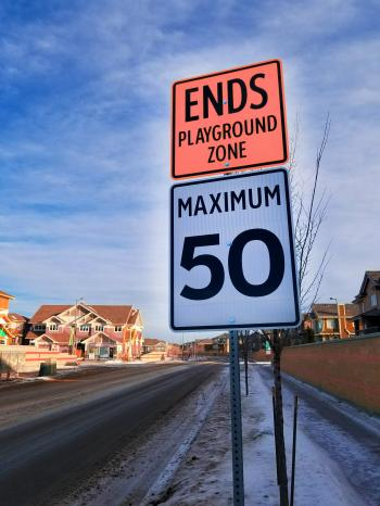 Photo of Ends Playground Zone Maximum 50 Street Sign