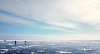Photo of Five People on Ice Field