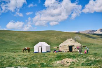 Photo of Hut And Tent On Grass Field
