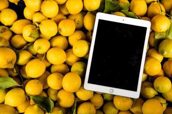 Photo of Ipad on Pile of Lemons