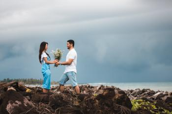 Photo of Man Giving Flowers to Woman
