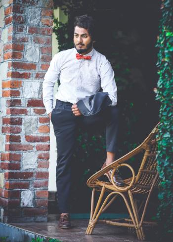Photo of Man in White Shirt and Black Pants