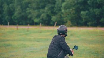 Photo of Man Wearing Black Helmet With Green Leaf Tree Plants