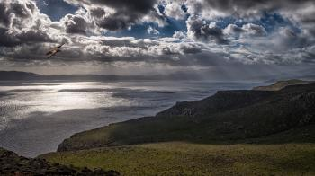 Photo of Ocean Under Cloudy Sky