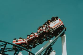 Photo of People Riding Roller Coaster