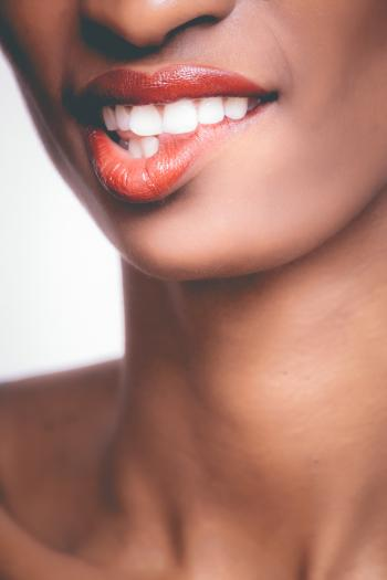 Photo of Person Biting It's Own Red Lips