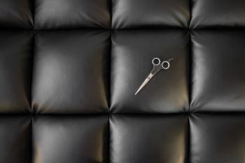 Photo of Scissor on Black Leather Cushion