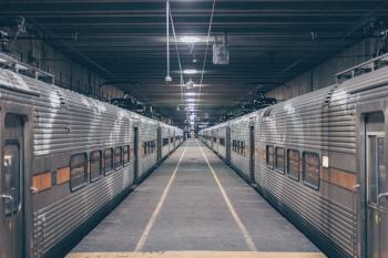 Photo Of Two Grey Trains In Station