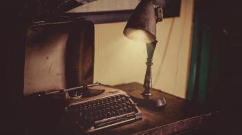 Photo of Vintage Typewriter and Lamp