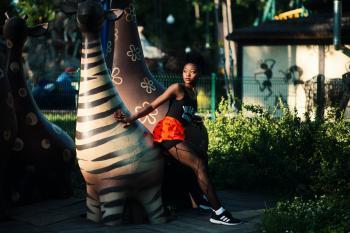 Photo of Woman Beside Zebra Statue