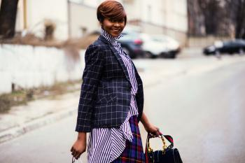 Photo of Woman in Black and Gray Blazer Holding Bag