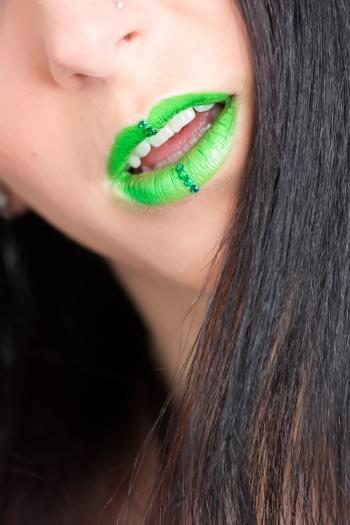 Photo of Woman in Green Lipstick