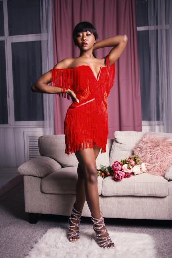 Photo of Woman in Red Fringe Mini Dress