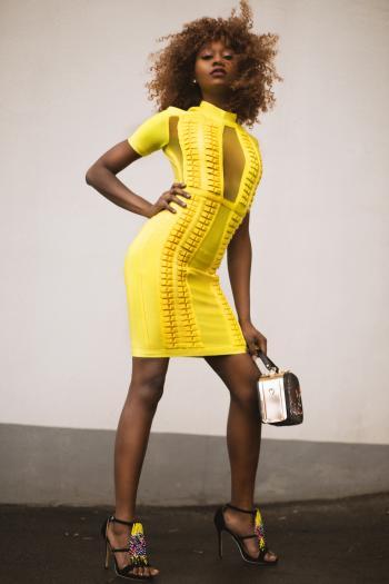 Photo of Woman in Yellow Dress Carrying Handbag
