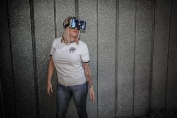 Photo of Woman Using Virtual Reality Headset