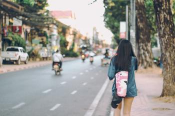 Photo of Woman Walking in the Street