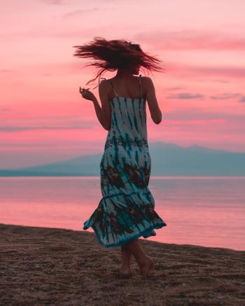 Photo of Woman Wearing Tie Dye Dress
