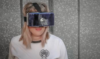Photo of Woman Wearing Virtual Reality Headset