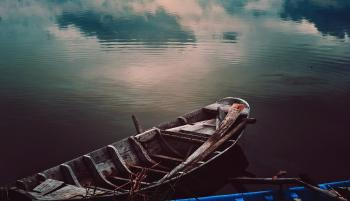 Photo of Wooden Fishing Boat on Water