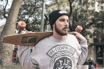 Photography of a Man Holding Longboard