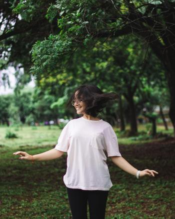 Photography of a Smiling Woman Near Trees