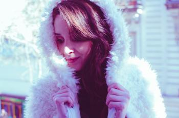 Photography of a Woman in White Fur Coat