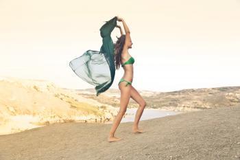 Photography of a Woman Wearing Green Bikini