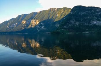 Photography of Body of Water Beside Green Mountain