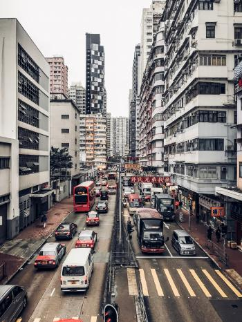 Photography of Buildings and Cars on Road