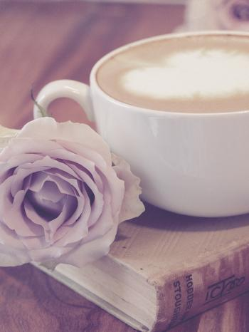 Photography of Flower Beside Coffee on Top of Book