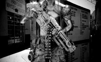 Photography of Human Holding Gun