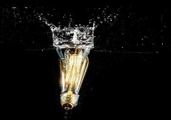 Photography of Light Bulb on Body of Water