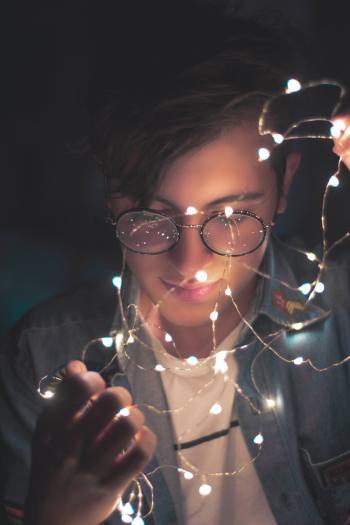 Photography of Man Wearing Eyeglasses