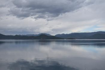 Photography of Mountains Near Body of Water