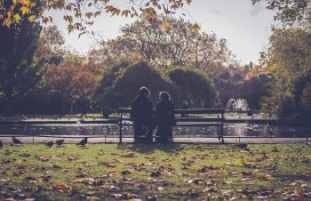 Photography of People Sitting on Bench