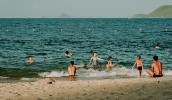 Photography of People Swimming in the Beach
