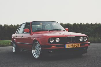 Photography of Red BMW on Asphalt Road