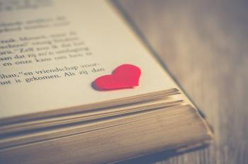 Photography of Red Heart on Book Page